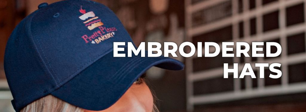 a navy hat that has been embroidered on a girls head with a logo