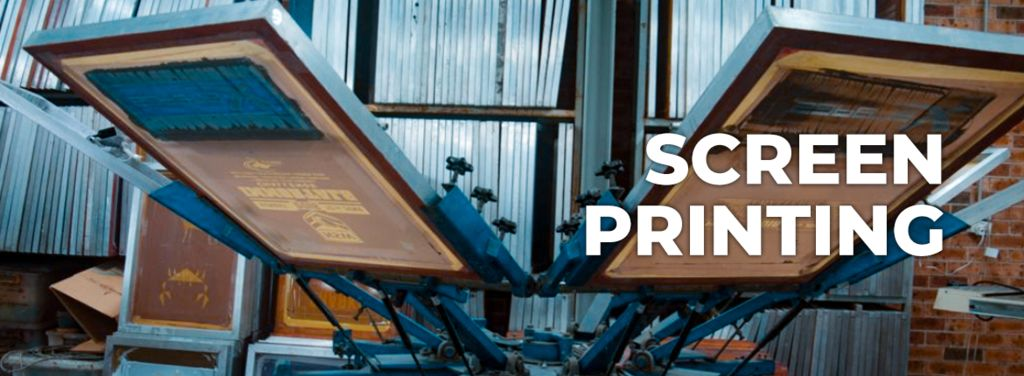 two screen printing machines open with a screen ready to be printed in a factory