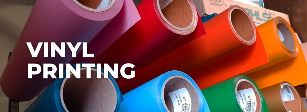 pink red orange yellow blue and green rolls of vinyl stacked